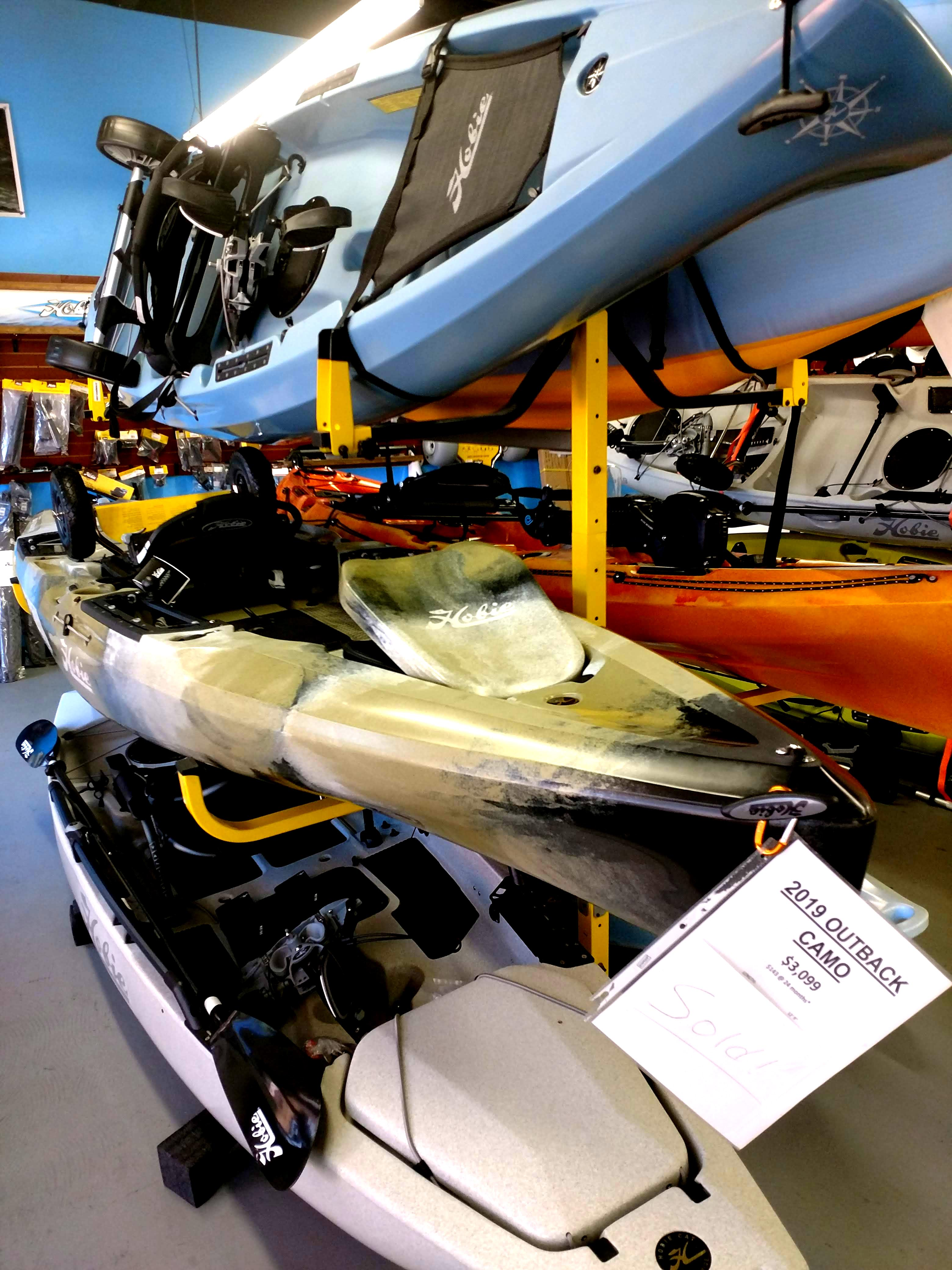 new ans used hobie kayaks on rack for sa